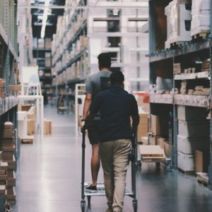 men-going-around-a-warehouse-1797428