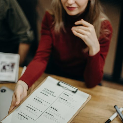 woman-holding-clipboard-3205566